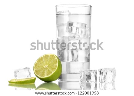 Ice cubes in glass with lime isolated on white - stock photo