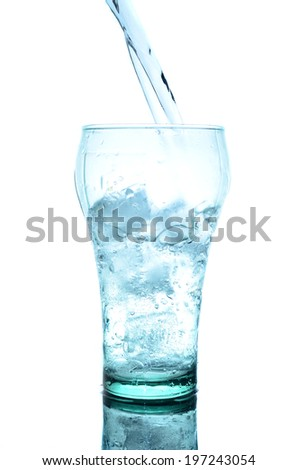 Ice cubes in glass with splash water on reflection surface