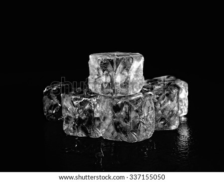 ice cubes on black background - stock photo