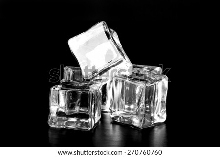 Ice cubes on black table. Selective focus.