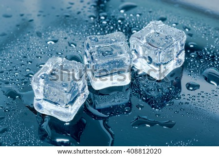 Ice cubes on black wet table. Selective focus. - stock photo