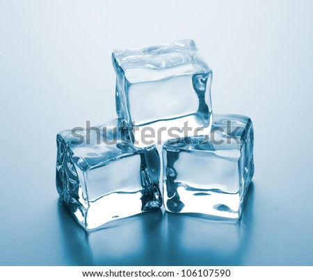 ice cubes on glass table. - stock photo