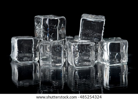 ice cubes on reflection table on black background