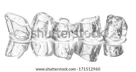 Ice cubes over white background - stock photo