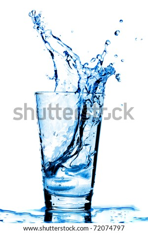Ice cubes splashing into glass of water, isolated on white