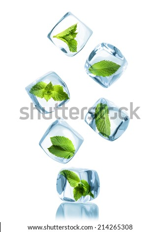 Ice cubes with green mint leaves isolated on white background. - stock photo