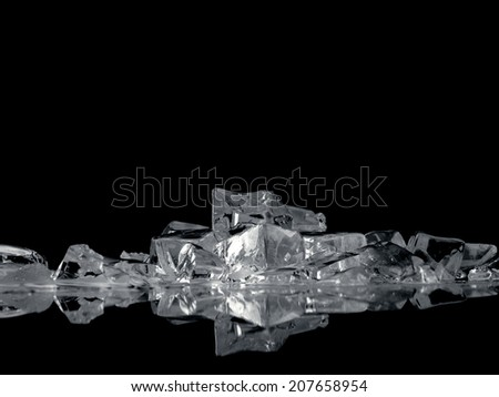 ice fantasy - pile of different bright ice cubes on reflection surface on  black background - stock photo