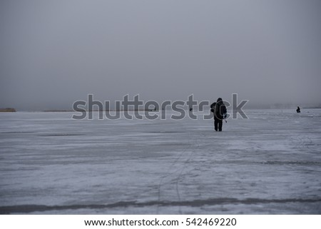 Ice fishers, early morning. Finland.