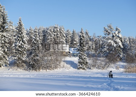 Ice Fishing,North-West of Russia - stock photo