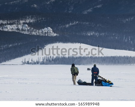 Ice fishing on Lake Granby, Colorado. - stock photo