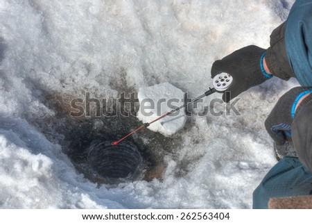 Ice fishing. Producing the jig effect - stock photo