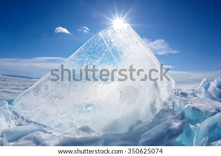 Ice floe and sun over winter Baikal lake