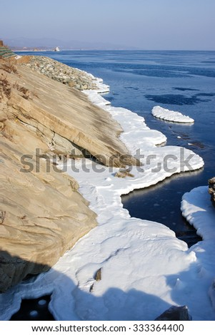 Ice floes in the sea, the block of ice on the sea, the winter sea and the ocean, Arctic, aquatic nature, the ice floe in the ocean, melting ice, spring in the North sea, Arctic in the spring. - stock photo