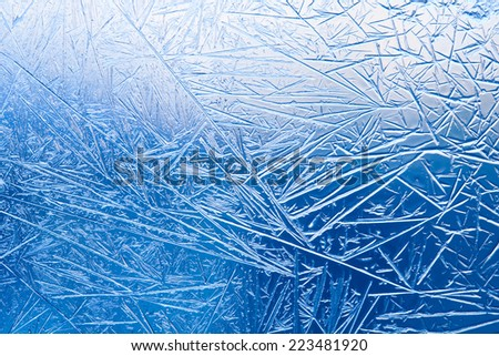 Ice flowers and frozen window macro view. Frost texture pattern. cold winter weather xmas background concept.   - stock photo