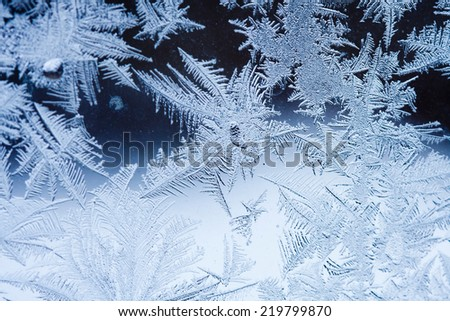 Ice flowers on glass - texture  - stock photo