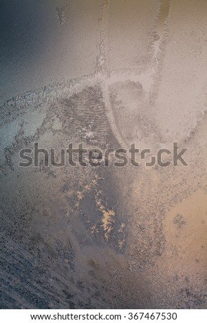 Ice flowers on glass - texture and background