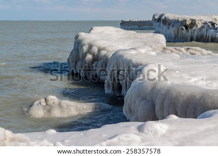 Ice formations at Lake Michigan created by waves of water freezing in midair - stock photo