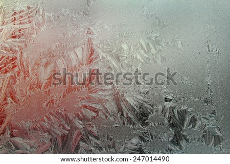 Ice frost on the window - Ice patterns on winter glass, background - stock photo