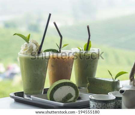 Ice green tea with fresh green tea and tea cake, close up - stock photo