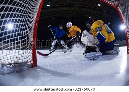 ice hockey goalkeeper  player on goal in action - stock photo