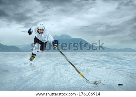 Ice hockey player at the ice. - stock photo