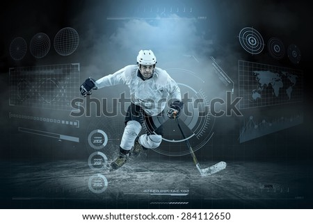 Ice hockey player on the ice around modern light - stock photo
