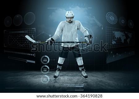 Ice hockey player on the ice around modern light - stock photo
