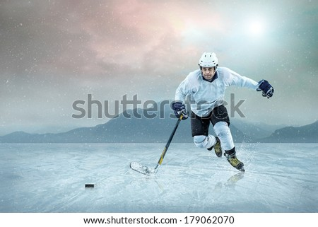 Ice hockey player on the ice, outdoor. - stock photo