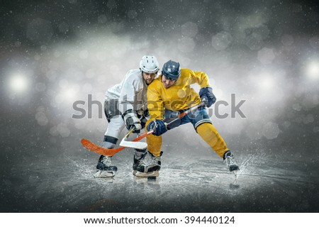 Ice hockey player on the ice, outdoors - stock photo