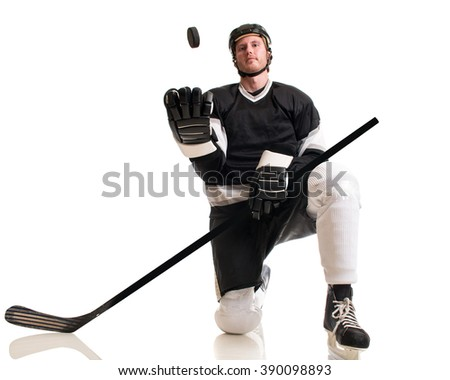Ice hockey player. Studio shot over white.
