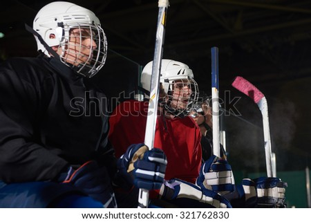 ice hockey players,  group of team friends waiting on bench to start  game
