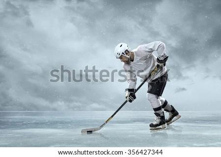 Ice hockey players on the ice - stock photo