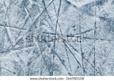 Ice hockey rink with traces from skates, top view - stock photo
