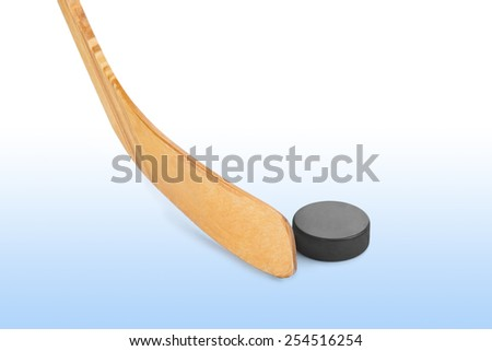 Ice hockey stick and puck isolated on white background - stock photo