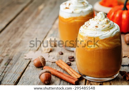 ice honey pumpkin spice latte with whipped cream. the toning. selective focus - stock photo