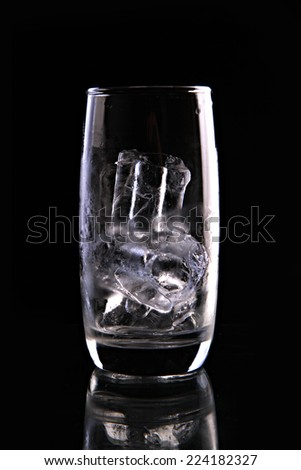 ice in a glass isolated on black background