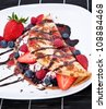 Ice in fresh Pan Cake with mixed fruits on black background - stock photo