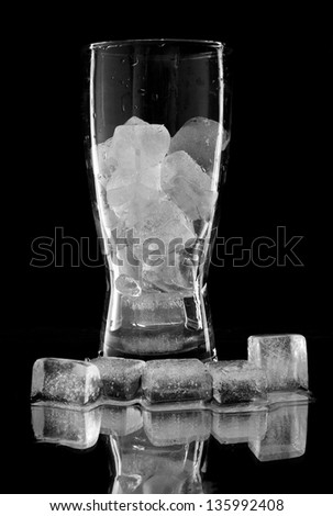 ice in glass on a black background - stock photo