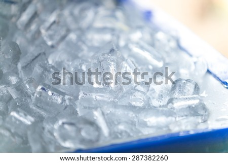 Ice in ice bucket. - stock photo