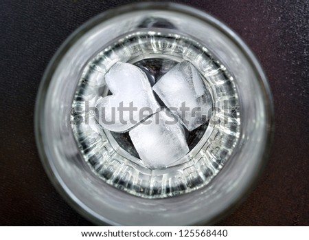 ice in the form of heart on the bottom of the glass