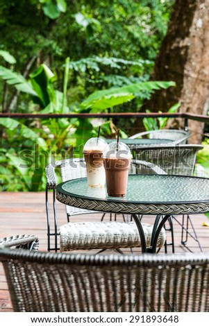 Ice Latte Coffee and Ice Chocolate in Plastic Glass, Thailand. - stock photo