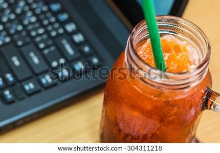 Ice lemon tea while working. - stock photo