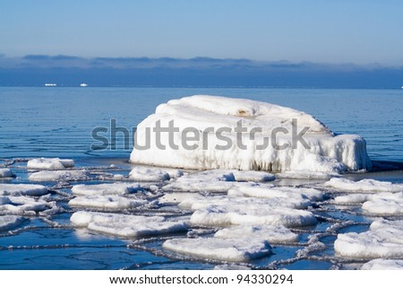 Ice melting in sea - stock photo