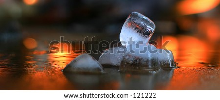 Ice melting  with flames on background.