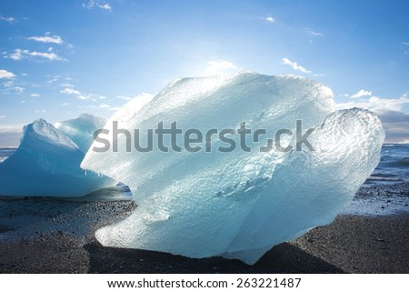 Ice on ice beach with water wave in Jokulsarlon, Iceland