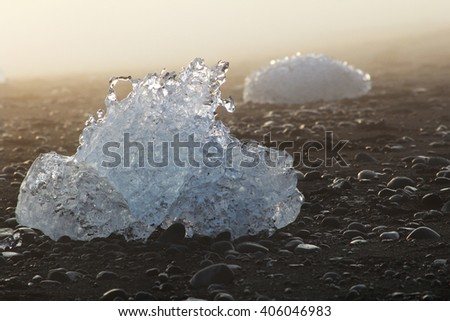 Ice on the shore of the beach with black sand. Iceland.