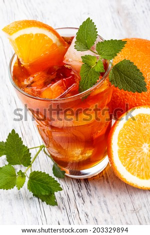 Ice orange tea on wooden table  - stock photo