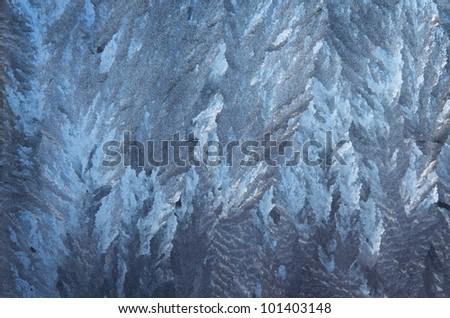 ice patterns on frozen winter window - stock photo