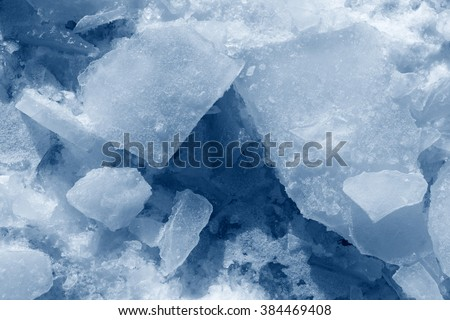 ice pieces and snow background texture blue - stock photo