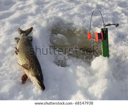 Ice pike fishing in Sweden - stock photo
